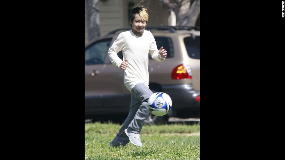 In March 2013, a soon-to-be 12-year-old Maddox played soccer with friends in a park.