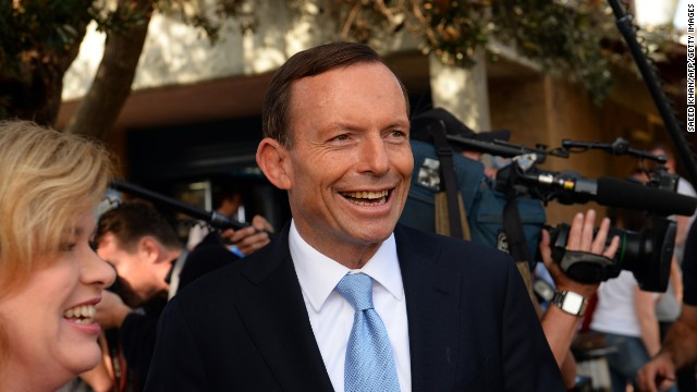 Australian opposition leader Tony Abbott smiles as he leaves a polling station after casting his vote in Sydney on September 7, 2013. Australians began voting in national elections with conservative challenger Tony Abbott heading for a thumping victory over Labor Prime Minister Kevin Rudd.