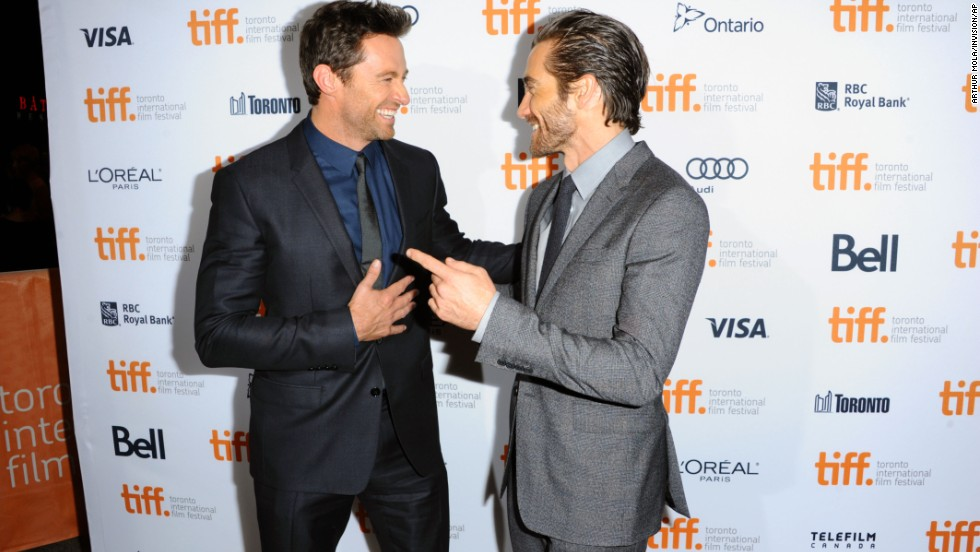 "Hugh Jackman, left, and Jake Gyllenhaal  arrive at the premiere of ""Prisoners"" at the Elgin Theatre on September 6."