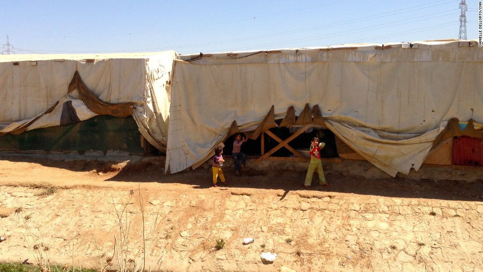 According to aid group workers, the sheriff in this Lebanon border town near Syria charges the refugees who set up shelter in the dirt here $100 a month.