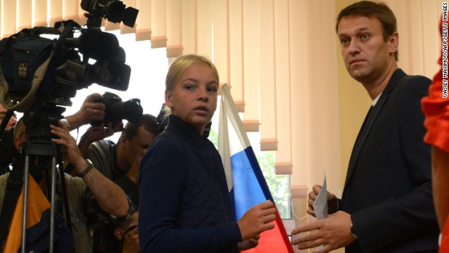 Alexei Navalny prepares to cast his ballot during a mayoral election in Moscow, on September 8, 2013, with his daughter, Dasha.
