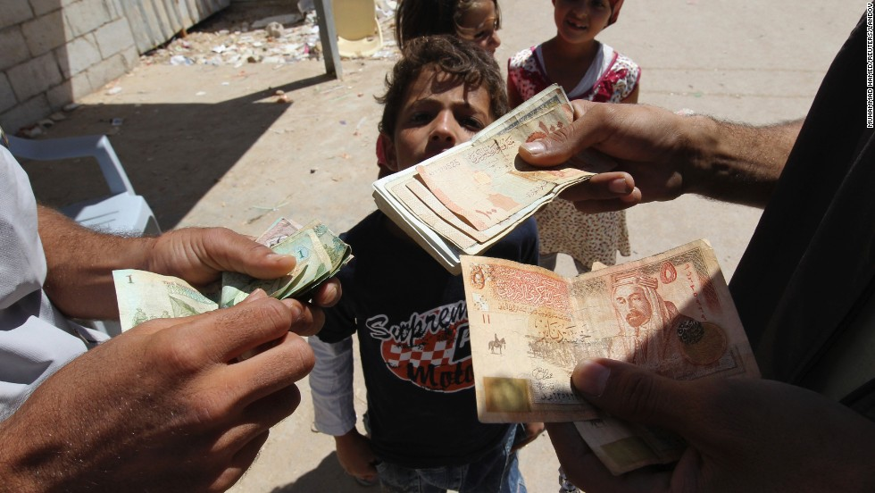 A refugee money-changer exchanges currency at the main market at the Zaatari refugee camp near Mafraq in September 2013.