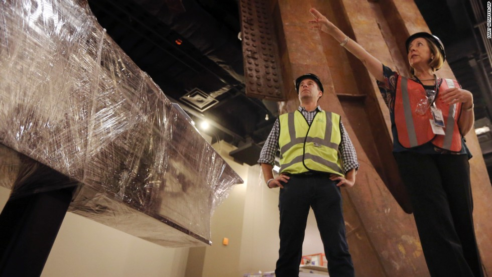 9/11 Memorial President Joe Daniels, left, and Museum Director Alice Greenwald speak during a tour. Several large artifacts from the original World Trade Center have been installed in the museum.