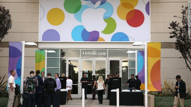 Members of the press and other guests arrive at Apple headquarters in Cupertino, California, for Tuesday's announcement.