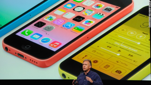 Apple senior vice president Phil Schiller presents the iPhone 5C, a cheaper, simpler new version of the phone, at an event on Tuesday.