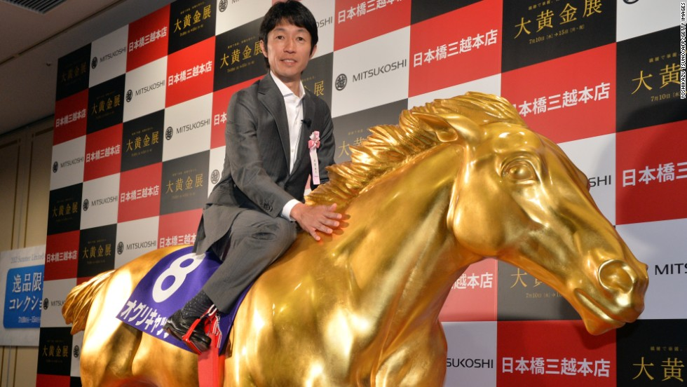 Japan's most famous  jockey is Yutaka Take, who has been likened to the David Beckham of his sport. Here the veteran is on board a golden replica of Oguri Cap, which won four Grade One races.