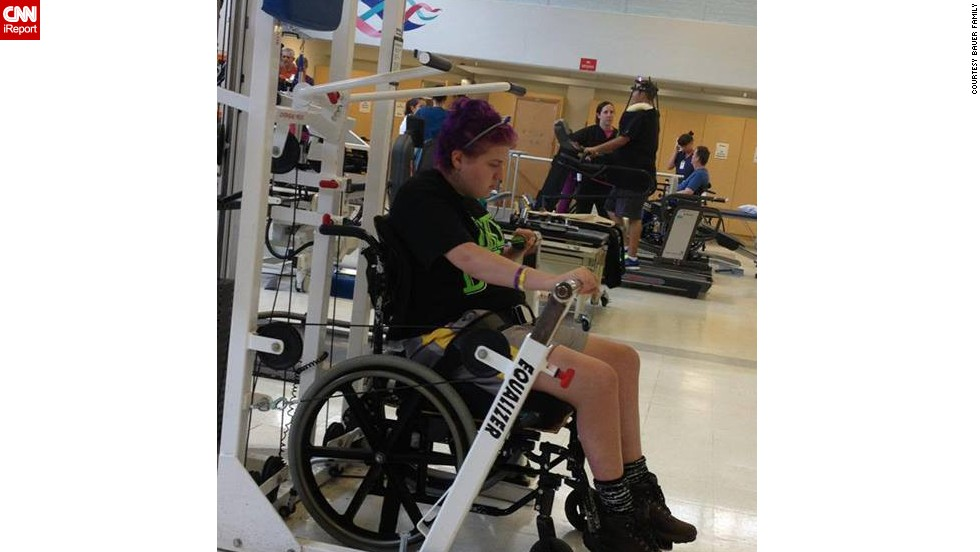Emily ends the month of May by pumping iron in her wheelchair.