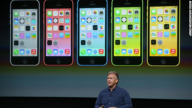 Phil Schiller, Apple senior vice president of worldwide marketing, touts the new iPhone 5C last week at Apple headquarters.