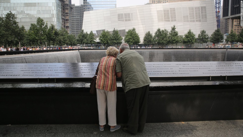 Visitors check out victims' names at the 9/11 Memorial in New York on September 10.