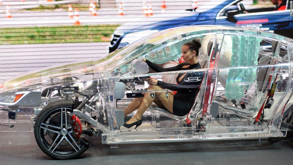 A model sits in a acrylic glass car body that shows the car technik at the IAA international automobile show on September 11, 2013 in Frankfurt, Germany.