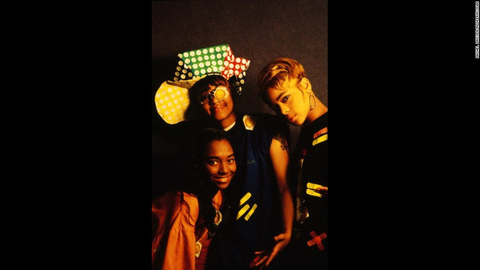"The ladies of TLC -- that would be Chilli, Left-Eye and T-Boz -- made their industry-changing entrance in 1992 with ""Ooooooohhh ... on the TLC Tip."" Between their frank approach to sex (""Ain't 2 Proud 2 Beg""), smart writing (""What About Your Friends"") and distinctive style (yep, the condoms), it makes sense that they <a href=""http://www.ew.com/ew/article/0,,310196,00.html"" target=""_blank"">were hailed as</a> ""a perfect pop group for the times."" Lisa ""Left-Eye"" Lopes died in 2002, but you can catch the surviving members on that NKOTB tour."