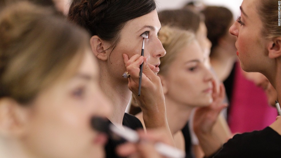 Models get their makeup done before the Rebecca Minkoff show.