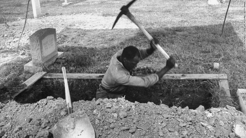 A man digs a grave for one of the girls.