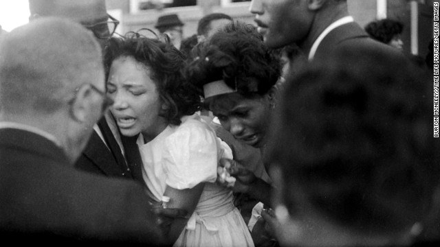 "Mourners embrace at the girls' funeral. In his eulogy, Dr. King said, ""These children -- unoffending, innocent and beautiful -- were the victims of one of the most vicious and tragic crimes ever perpetrated against humanity."""