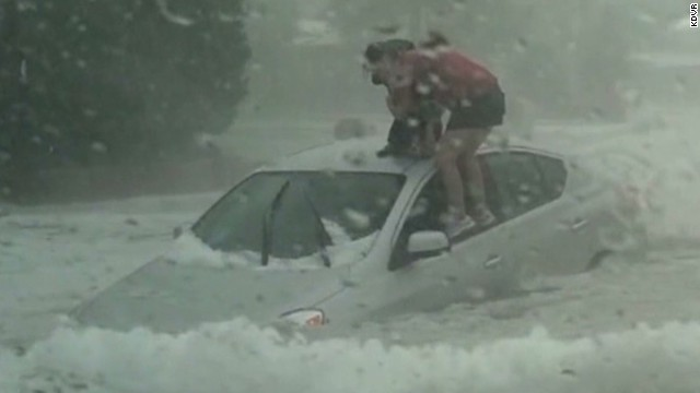 Mom and daughter stuck in hail, flood