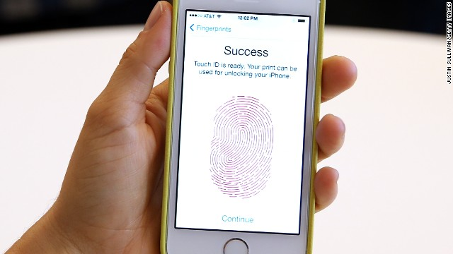 The new iPhone 5S with fingerprint technology is displayed during an Apple product announcement at the Apple campus on September 10, 2013 in Cupertino, California.