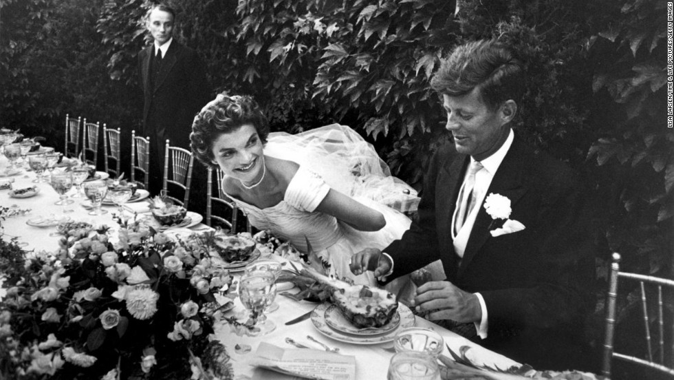 John and Jackie Kennedy prepare to enjoy lunch during their wedding reception in Newport, Rhode Island, on September 12, 1953. Sixty years later, look back at their first day as husband and wife.