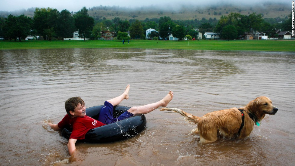 Nicky Toor, 15, floats on the flooded lawn of North Boulder Park in Boulder on September 12.