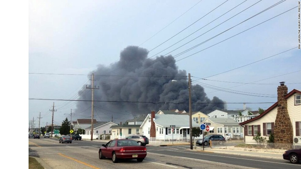 Smoke rises in the distance over homes in the Seaside Heights area.