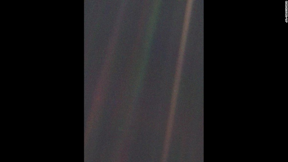 "This image of Earth, dubbed ""Pale Blue Dot,"" is a part of the first ""portrait"" of the solar system taken by Voyager 1. The spacecraft acquired a total of 60 frames for a mosaic of the solar system from a distance of more than 4 billion miles from Earth. Earth lies right in the center of one of the scattered light rays, which are the result of taking the image so close to the sun."