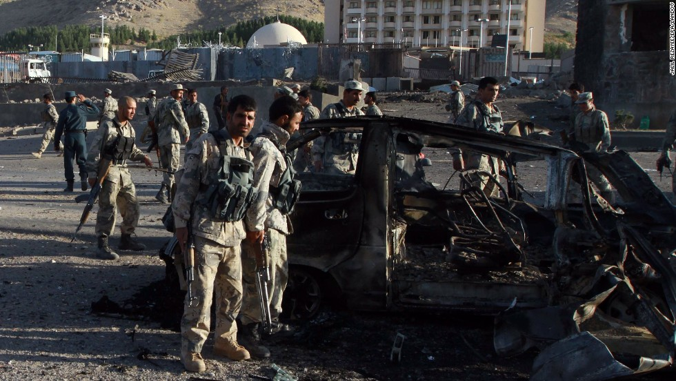 Afghan security officials inspect the scene of the attack on September 13. Seven attackers traveling in two vehicles were killed, said Mohammad Ayoub Salangi, deputy Afghan interior minister.