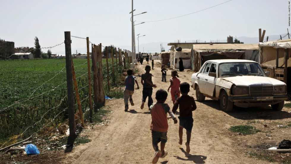Syrian refugee children run near their tents at a temporary refugee camp near the Lebanese border in September 2013.