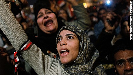 CAIRO, EGYPT - FEBRUARY 11: A woman cheers in Tahrir Square after it is announced that Egyptian President Hosni Mubarak was giving up power February 11, 2011 in Cairo, Egypt. After 18 days of widespread protests, Egyptian President Hosni Mubarak, who has now left Cairo for his home in the Egyptian resort town of Sharm el-Sheik, announced that he would step down.