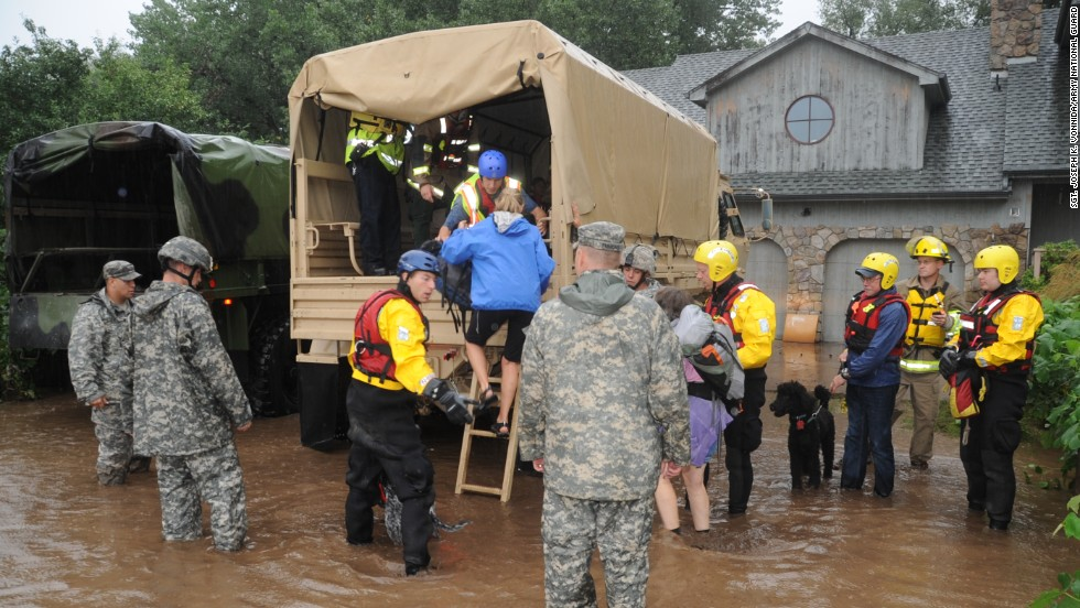 Colorado National Guardsmen assist residents in unincorporated areas of Boulder County, Colorado. Residents were evacuating the area on Thursday, September 12.