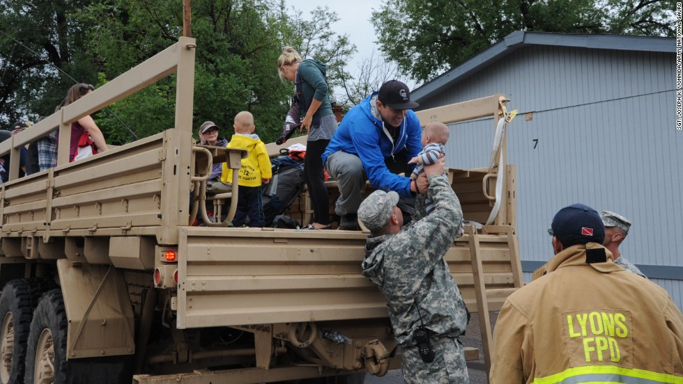 Members of the Colorado National Guard help Boulder County authorities evacuate residents of Lyons, Colorado, to Longmont, Colorado, on Friday, September 13.  Flooding has hit the area hard, washing out roads, damaging bridges and destroying homes.