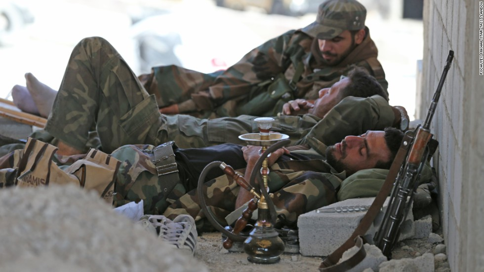 Syria's pro-Assad militia rest near Maalula, Syria, on Friday, September 13.