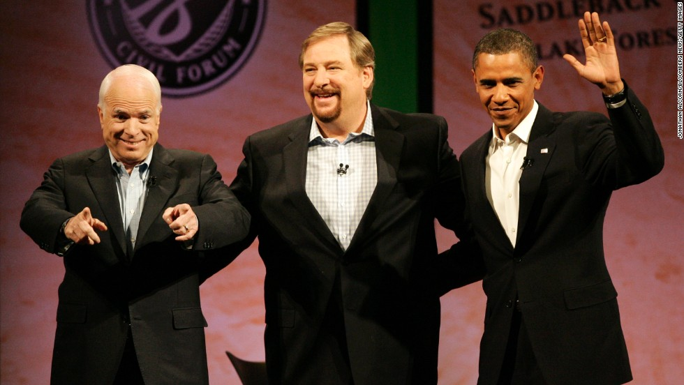 Presidential candidates Sens. John McCain and Barack Obama join Warren onstage at the Saddleback Civil Forum on the Presidency at Saddleback Church on August 16, 2008.
