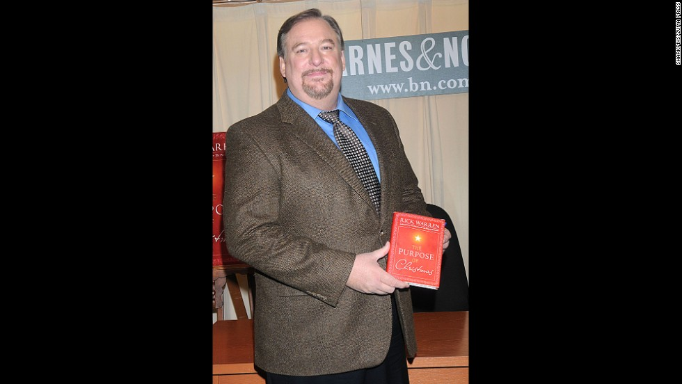 "Warren poses with a copy of his book ""The Purpose of Christmas"" during a book-signing in 2008 in New York."
