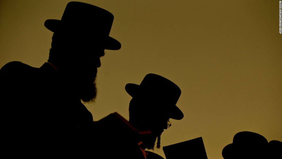 Ultra-Orthodox Jewish men pray along the Ayarkon River in the city of Ramat Gan near Tel Aviv.