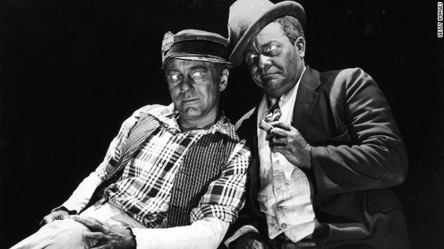 American actors and comedy partners Charles Correll (L) and Freeman Gosden lean against each other in blackface makeup in a 1949 promotional portrait.