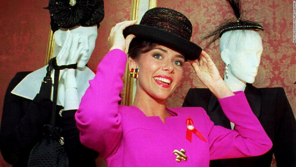 Miss America 1993, Leanza Cornett, tries on a hat in New York in 1992. Cornett announced that she would wear only U.S. fashions in support of U.S. textile and apparel workers.