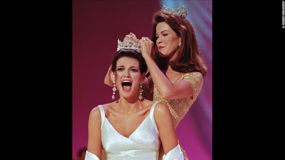 Miss Ilinois, Katherine Shindle, left, reacts as she's crowned the 1998 Miss America by Tara Holland at the Miss America Pageant in Atlantic City.