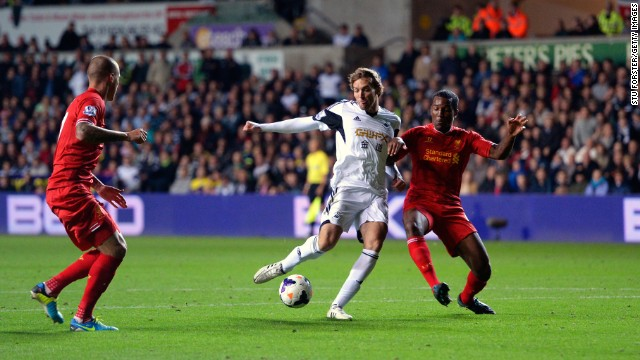 Swansea's Spanish striker Michu struck a second half equalizer to deny Liverpool victory.