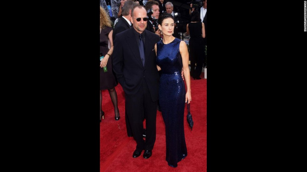 "Back when they were still together, Bruce Willis and Demi Moore made a sophisticated couple on the red carpet, as they did here at the 1997 Emmys. Moore's ""If These Walls Could Talk"" was nominated for an Emmy."