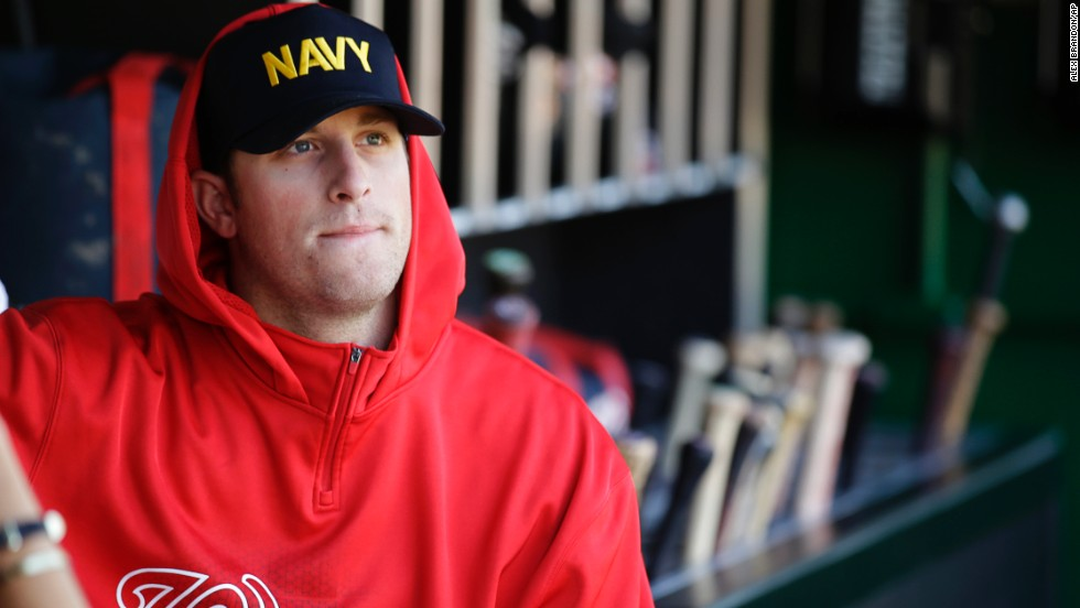 Washington Nationals relief pitcher Ian Krol wears a Navy hat in the dugout of Nationals Park in Washington before a game against the Atlanta Braves on September 17.