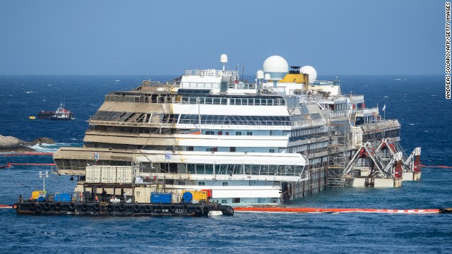 A picture taken on September 17, 2013 shows the wreckage of Italy's Costa Concordia cruise ship which begins to emerge from water near the harbour of Giglio Porto.