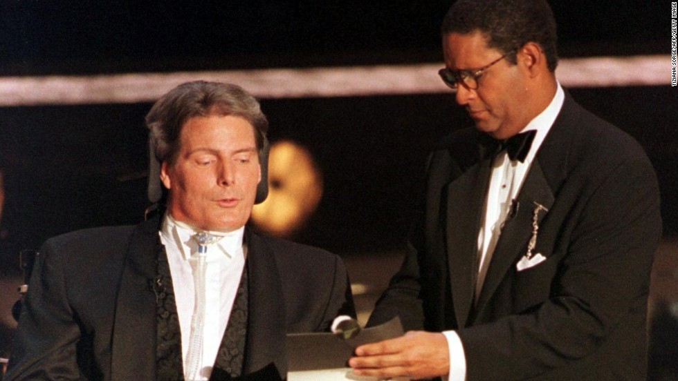 Bryant Gumbel, right, hosted the 49th annual Emmy Awards in 1997 and has overwhelmingly been panned as one of the worst. Seen here helping the late actor Christopher Reeve read the winner for outstanding supporting actor for a miniseries or special, this was about as exciting as Gumbel's hosting duties got.