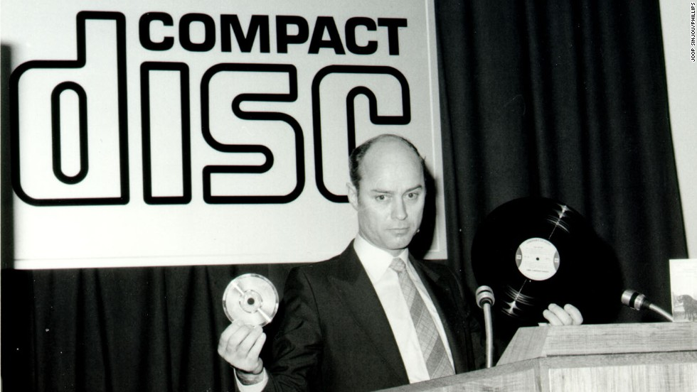 The compact disc (CD) promised high-quality digital sound in a portable optical format. Sales peaked in the late '90s and early 2000s, though it's still prominent today. The disc became a collaboration between Sony and Philips; here, Philips' Joop Sinjou shows his company's version on March 9, 1979.