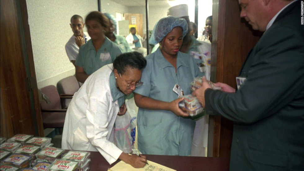 Food service employees at the Veterans Hospital in Miami line up to receive food rations on January 3, 1996. Many federal employees faced financial hardships during the shutdown.
