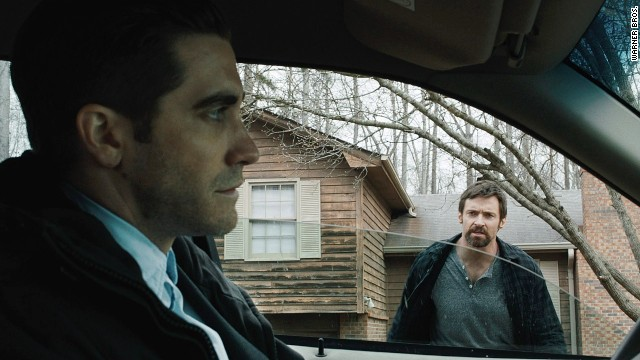 "Jake Gyllenhaal stars as a moody investigator with Hugh Jackman as a worried father in ""Prisoners."""