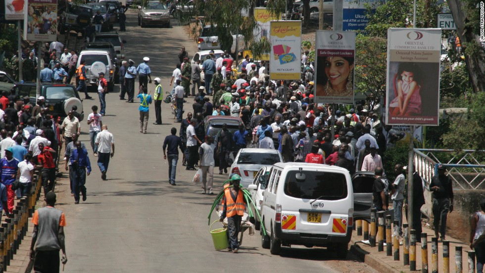 Crowds gather outside the upscale shopping mall. The interior ministry urges Kenyans to keep off the roads near the mall so police can ensure everyone inside has been evacuated to safety.