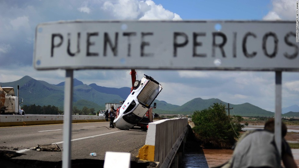 A van is recovered September 20, after being trapped by floodwaters in Navolato, Mexico.
