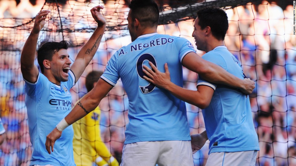Sergio Aguero (left) celebrates with Alvaro Negredo (center) and Samir Nasri after scoring Manchester City's third goal against Manchester United and his second of the match.