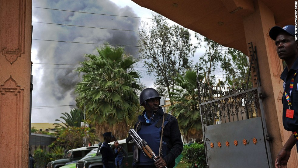 A Kenyan police officer guards the entrance of a building near the mall on September 23.