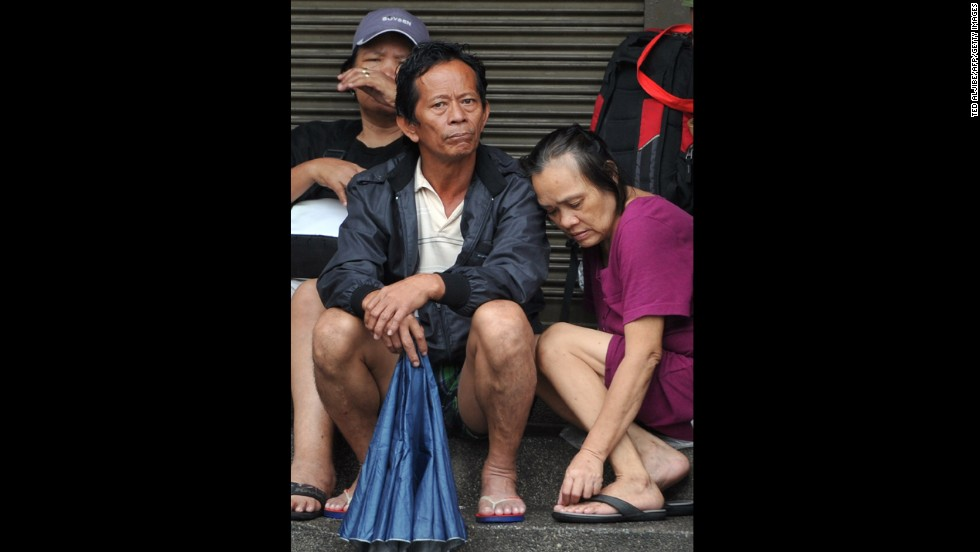 Rescued residents wait for floods to subside after torrential rains pounded the island of Luzon on September 23.