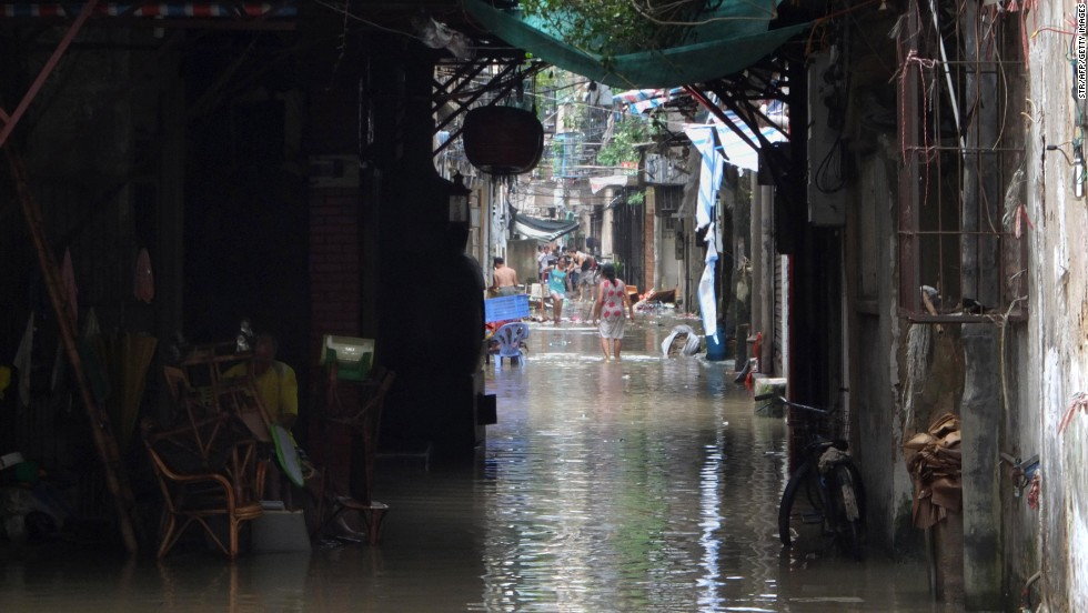 People walk through a flooded residential area in Shantou, China, on September 23.
